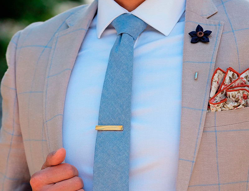 man-in-blazer-with-necktie-and-tieclip-1600