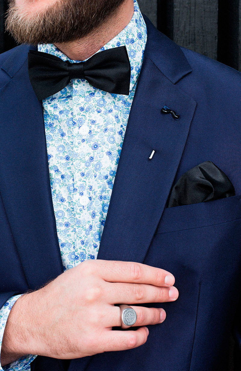 man-in-suit-with-bow-tie-pocket-square-and-lapel-pin-1600