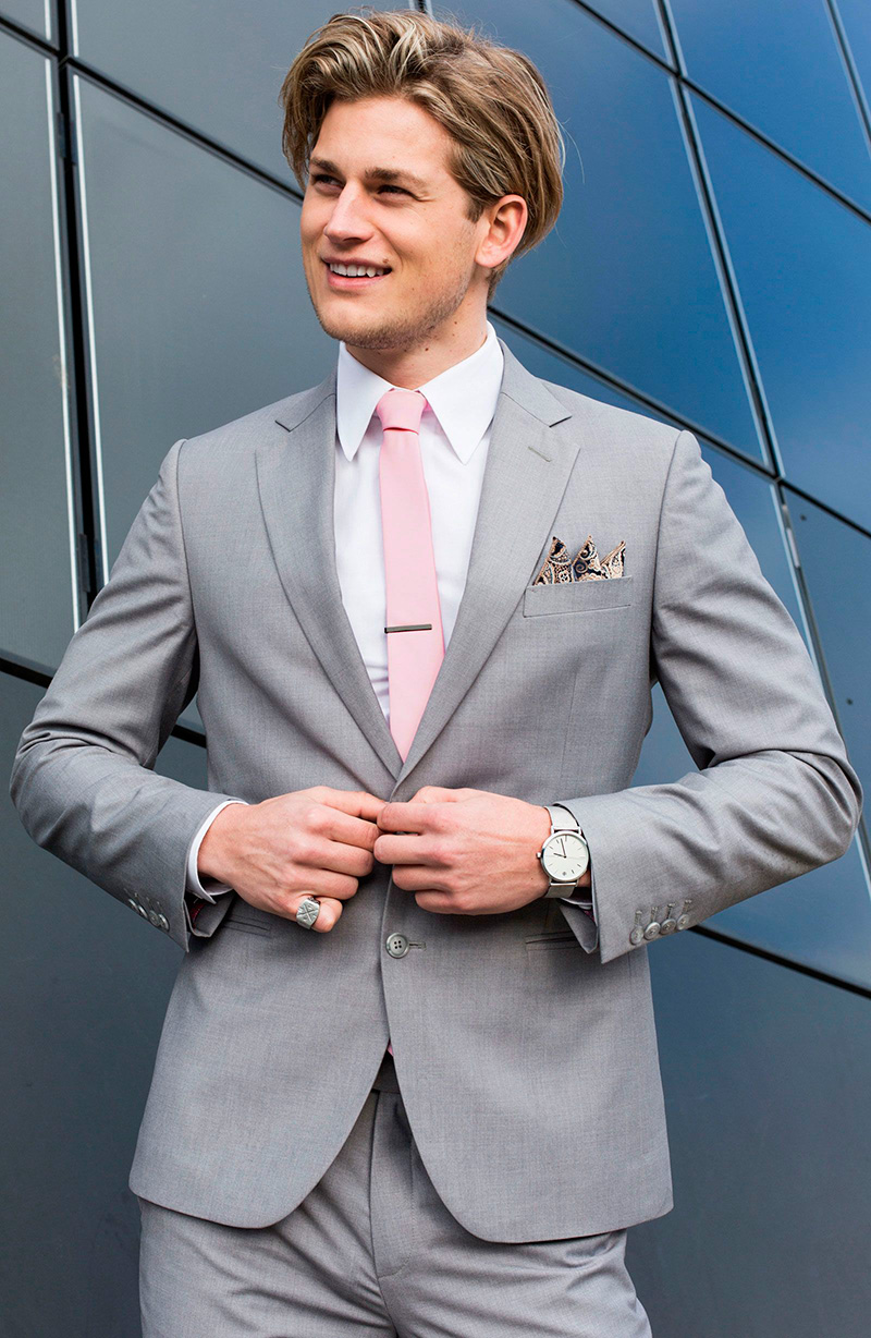 man-in-suit-with-pink-necktie-and-other-accessories-1600